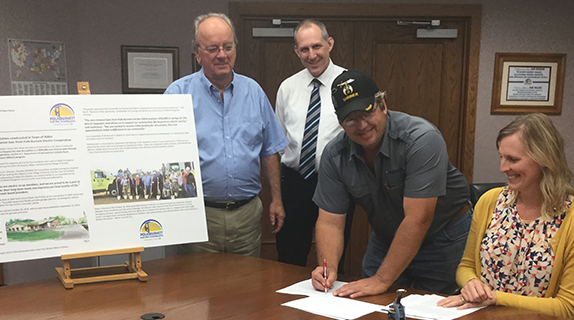 Co-op and fire association sign loan papers
