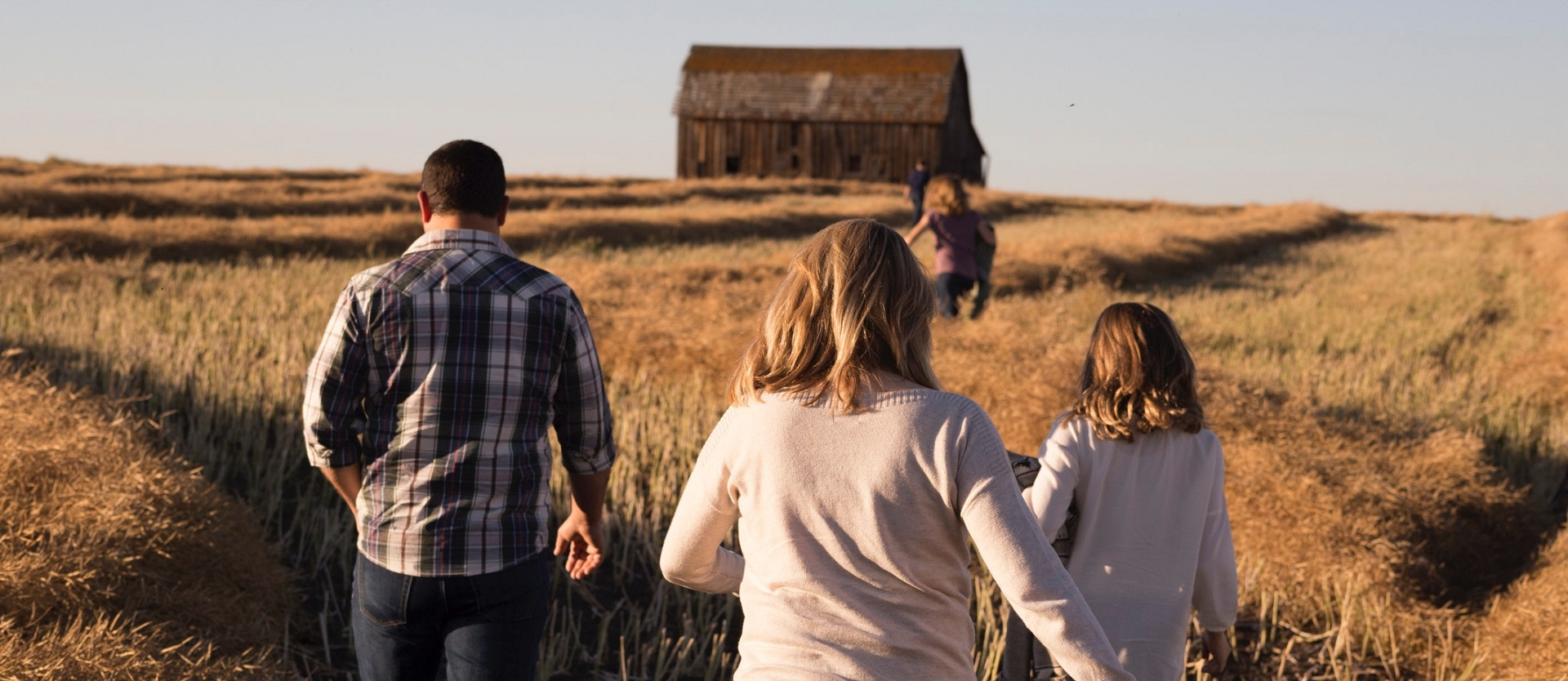 Picture of family walking in field