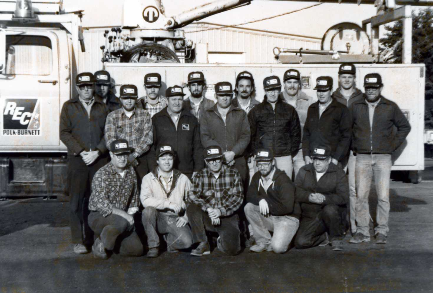 https://www.polkburnett.com/sites/pbec/files/revslider/image/Group_Photo_Linemen_by_Truck_Mid_80s.jpg